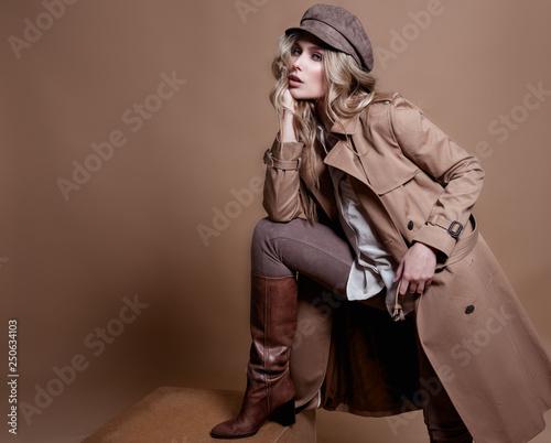 Obraz High fashion portrait of stylish blond woman in total beige look over beige background. - fototapety do salonu