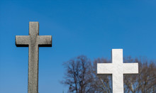 Graves With Crosses At Cemetery
