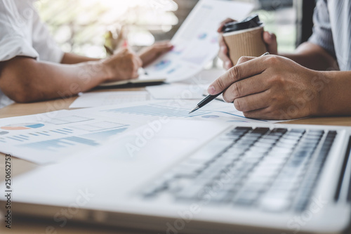 Business team meeting working with new startup project, discussion and analysis data the charts and graphs, laptop using, Business finances and accounting concept - 250652753