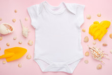 Mockup Flat Lay White Baby Bodysuit Shirt On A Pink Background With A Nautical Theme, Shells And The Sea With Toys