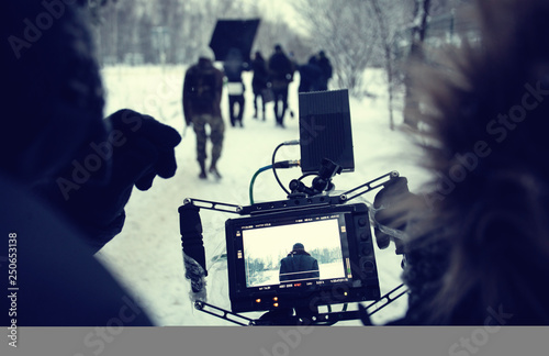 Obraz na plátne Shooting a feature film, backstage on the set in the street in the winter, the view from the camera