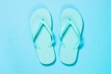 Blue Flip Flops On Blue Background.