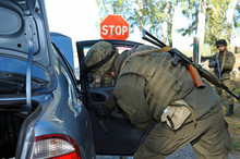 At The Checkpoint, Training. Soldiers Searching Personal Belongings Of Suspect In A Stopped Car