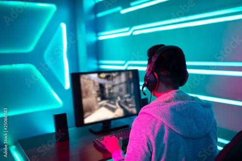 Fototapeta  Young Asian cyber sport gamer