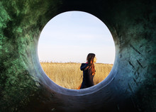 Girl Through Hole In Sculpture...