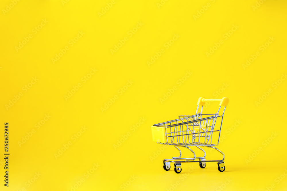 Fototapety, obrazy: Shopping cart trolley basket is empty on a bright yellow background. Conception Festive Sale Discount. Trading Supermarket Retail.Copy space .