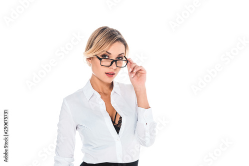 Photo attractive blonde teacher in blouse with open neckline taking off glasses isolat