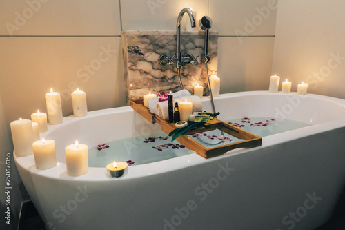Leinwand Poster Spa bath with flowers, candles and tray