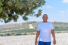 Portrait Of Handsome Old Active Senior Man Outdoors. Sporty Athletic Elderly Businessman On Nature Background. Senior Farmer Standing In Meadow Background.