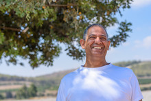 Portrait Of Handsome Old Active Senior Man Outdoors. Mature Male With Kind Eyes And Beautiful Smile.Sporty Athletic Elderly Businessman On Nature Background.