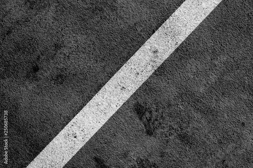 Photo Black Grunge Floor with White Painted Line Marking