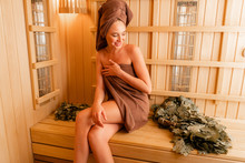 Young Woman Relaxing In A Saun...