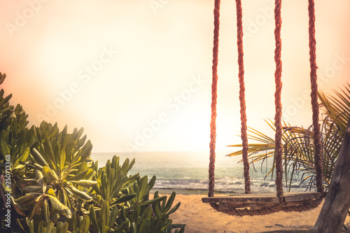 Cadres-photo bureau Palmier Travel lifestyle beach swing sea sunset palm trees sunlight island background vintage style copy space