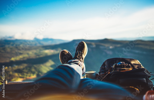 Poster Relaxation view trekking feet tourist backpack photo camera in auto on background panoramic landscape mountain, vacation concept, foot photograph hiking relax in auto, photographer enjoy trip holiday, mockup sky