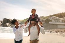 Family Having Fun On Beach Vac...