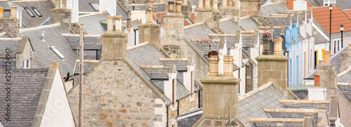 Wall Murals Northern Europe Old croft houses in Cullen, fishing village on Moray Firth, Scotland. Cullen Viaduct in the background, old roofs and chimneys