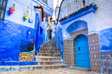 Fototapeta Na drzwi - Amazing view of the street in the blue city of Chefchaouen. Location: Chefchaouen, Morocco, Africa. Artistic picture. Beauty world