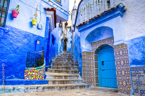 Photo Stands Morocco Amazing view of the street in the blue city of Chefchaouen. Location: Chefchaouen, Morocco, Africa. Artistic picture. Beauty world