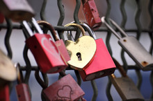 Red And Golden Padlocks With H...