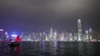 WS City skyline across Victoria Harbour at night, junk ship with red sails crossing harbor/ Hong Kong, China