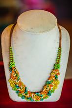 Beautiful Stone Necklace On Jewelry Window Display In Jewelry Shop.