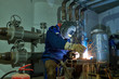 Welder worker at industrial arc welding work