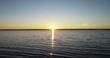 Sunset of the autumn sun over the Rybinsk reservoir (sea)