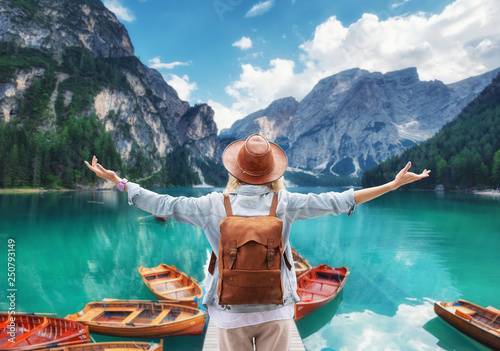 Montage in der Fensternische Blau Traveler look at the mountain lake. Travel and active life concept. Adventure and travel in the mountains, .Lago di Braers lake, Dolomite Alps, Italy.