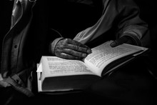 Old Lady Reading A Book In Black And White