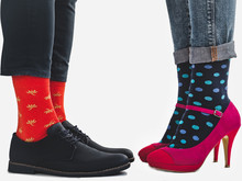 Men's And Women's Trendy Shoes, Blue Trousers And Beautiful, Multicolored Socks On A White, Isolated Background. Close-up. Side View. Concept Style And Elegance