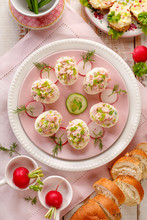 Deviled Eggs, Stuffed Eggs Filled With A Paste Made From Smoked Ham, Mayonnaise, Egg Yolks And Fresh Chive On A Plate, Top View. Tasty Breakfast, Appetizer For Party Or Holiday Meals