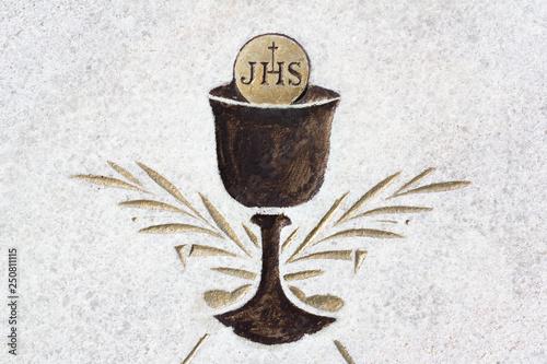 Vászonkép Eucharist - christian sacral ritual with cup, sacramental wine and bread
