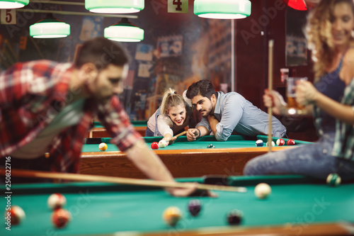 Canvas Print billiard game -Funny time with friends .