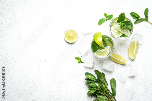 Fototapeta Mojito cocktail with mint and lime on a light background Copy space top view. obraz na płótnie