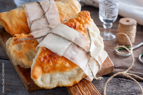 hot homemade pasties on a wooden board Fototapete