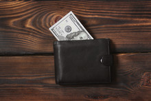 Money In Your Wallet. Dollars On A Wooden Background.