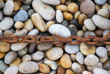 Rusty Chain Laid On Pebbles, C...