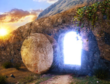 He Is Risen. Crucifixion At Sunrise. Light From Within The Tomb Of Jesus. Outside View On Tomb.