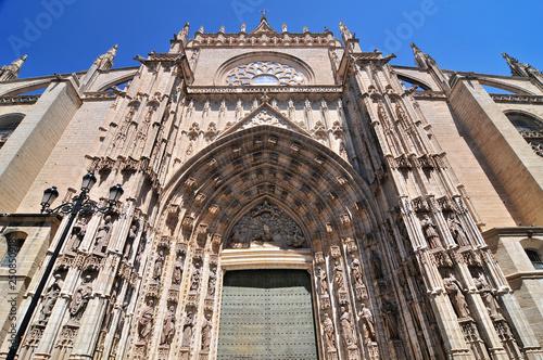 Photo Door of Assumption (Spanish: Puerta de la Asuncion) of the Sevilla Cathedral in Spain, main portal of the west facade