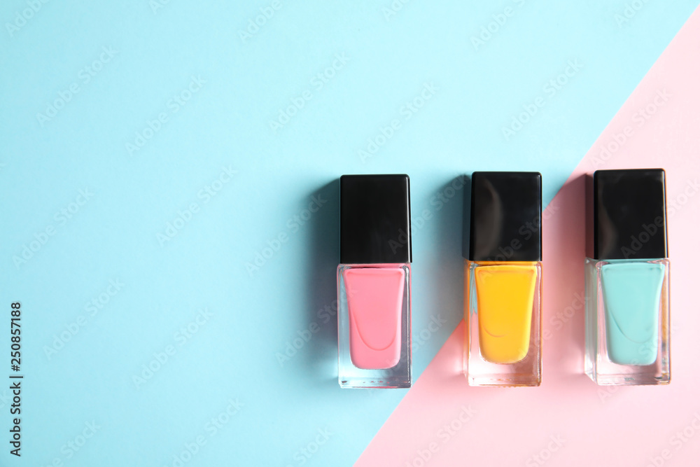 Fototapety, obrazy: Bottles of nail polish on color background, top view with space for text
