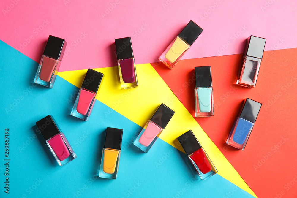 Fototapety, obrazy: Bottles of nail polish on color background, top view