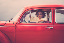 Serious Lady On A Old Retro Nice Red Car Looking At You With Open Window Glass - Traveler With Hippy Freedom Lifestyle And Alternative Vehicles