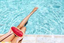 Girl Eating Watermelon By Pool