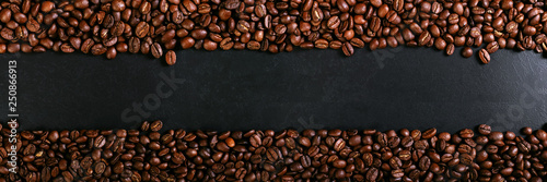 aroma-roasted-coffee-beans-on-rustic-tabletop-brown-banner-background