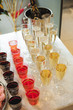 buffet table with snacks, cakes, drinks and champagne. slide champagne on the background