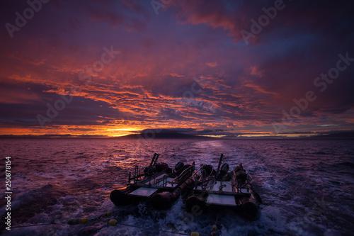 Dark purple sunset colors over an ocean landscape