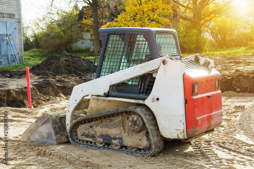 Photo small excavatot at construction site