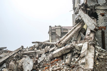 A Huge Pile Of Gray Concrete Debris From Piles And Stones Of The Destroyed Building. Copy Space.
