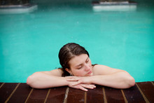 Woman Laying On Edge Of Hot Tub