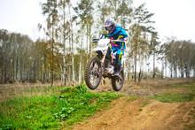 Motocross Rider Performing Trick On Dirt Road